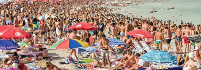 People sunbathing on a crowded beach
